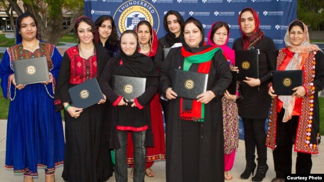 Graduates of the 2013 class of Project Artemis are seen with their diplomas.  (Courtesy Thunderbird School of Global Management)