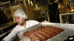 FILE - A chocolate factory worker.