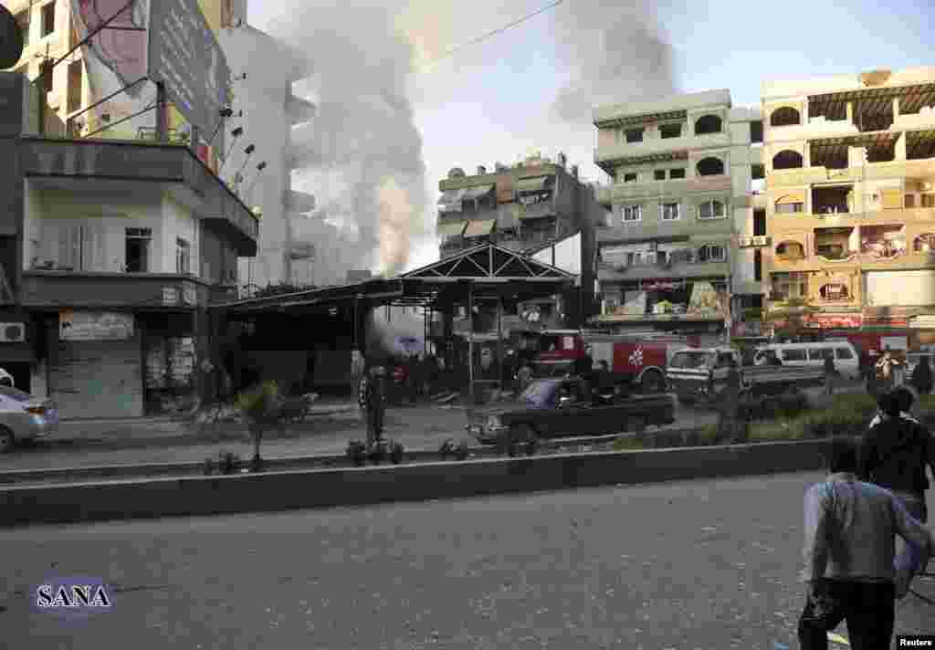 The site of a blast in Jaramana district, near Damascus, is seen in this handout photograph released by Syria's national news agency SANA, November 28, 2012.