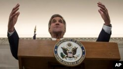 U.S. Secretary of State John Kerry, gestures during a press conference before heading to Jordan, following a day of meetings in Vienna, Oct. 23, 2015.