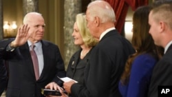 Vice President Joe Biden administers the Senate oath of office to Sen. John McCain, R-Ariz., accompanied by his wife, Cindy McCain, and his family during a a mock swearing-in ceremony in the Old Senate Chamber on Capitol Hill in Washington, Jan. 3, 2017.