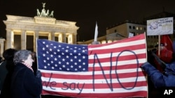 Protesters attend an anti-Trump rally in front of the Brandenburg Gate in Berlin, Germany, Jan. 20, 2017.