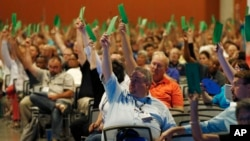 "Members attending the Southern Baptist Convention vote to formally condemn the political movement known as the ""alt-right,"" in a national meeting, June 14, 2017, in Phoenix."