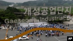 South Korean workers and owners who run factories in the stalled Kaesong industrial complex stage a rally insisting the normalize the operation of the industrial complex at the Imjingak Pavilion near the border village of Panmunjom in Paju, north of Seoul