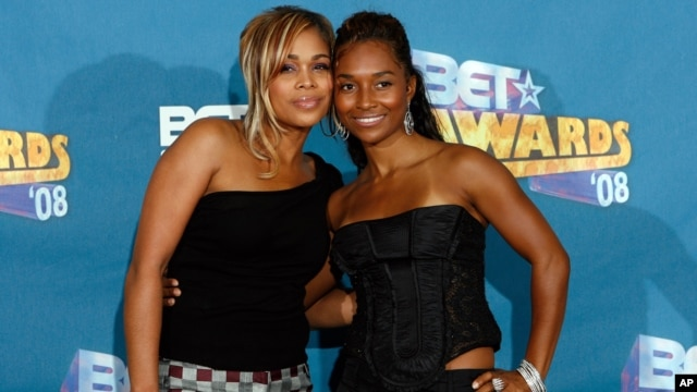"Tionne ""T-Boz"" Watkins, left, and Rozonda ""Chilli"" Thomas pose backstage at the BET Awards in Los Angeles."