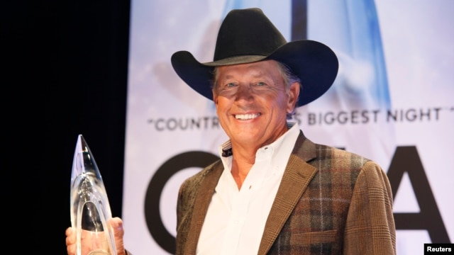 George Strait poses backstage with his Entertainer of the Year award at the 47th Country Music Association Awards in Nashville, Tennessee, Nov. 6, 2013.