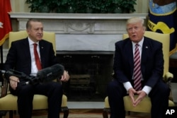 FILE - President Donald Trump meets with Turkish President Recep Tayyip Erdogan in the Oval Office of the White House in Washington, May 16, 2017.