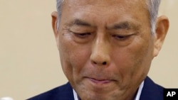 FILE - Tokyo Gov. Yoichi Masuzoe bites his lips while listening to a reporter's question during a press conference at Tokyo Metropolitan Government headquarters in Tokyo, June 6, 2016. Masuzoe announced his resignation June 15.