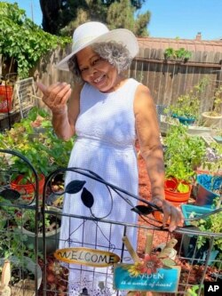 """This photo shows Lagetta Wayne, 78, in her garden in Suisun City, Calif., on Aug. 10, 2021. Wayne is among a growing number of """"grandfluencers,"""" folks 70 and up who are making names for themselves on social media. (KiKi Rose via AP)"""