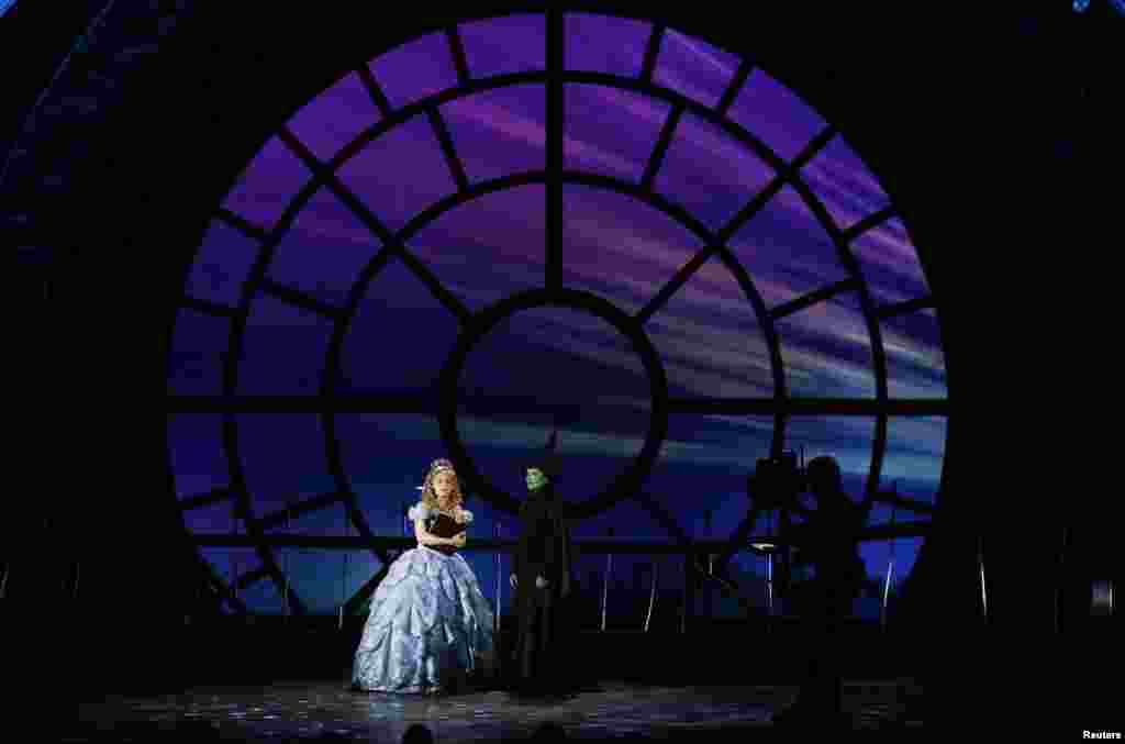 "Actors Jennie Barber (left) and Christine Dwyer perform a scene from ""Wicked"" onstage during the American Theatre Wing's 68th annual Tony Awards at Radio City Music Hall in New York, June 8, 2014."