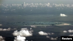 Wilayah Kepulauan Spratly di Laut China Selatan yang disengketakan di sebelah barat Palawan, Filipina.