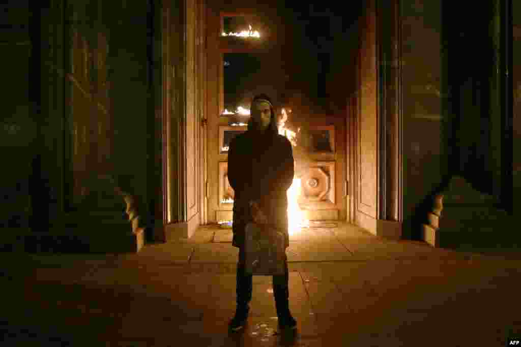 Russian artist Pyotr Pavlensky poses after setting fire to the doors of the headquarters of the FSB security service, the successor to the KGB.