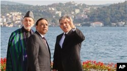Afghan President Hamid Karzai, left, Turkish President Abdullah Gul, right, and Pakistan President Asif Ali Zardari pose for a group photo after meetings in Istanbul, Turkey, November 1, 2011.