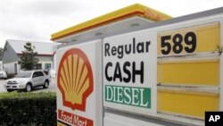 Gasoline priced at $5.89 for regular is advertised at a U.S. Shell station, Monday, Feb. 27, 2012, in Orlando, Florida. Oil prices are falling as investors lock in profits after a seven-day surge.
