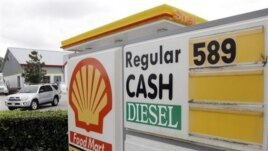 Gasoline priced at $5.89 for regular is advertised at a U.S. Shell station, Monday, Feb. 27, 2012, in Orlando, Florida.