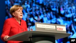 FILE - German Chancellor speaks during a party conference of her Christian Democratic Union (CDU) in Essen, Germany, Dec. 6, 2016. Analysts say German Merkel is the European leader Moscow would most like to see voted out of power.