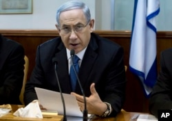 Israeli Prime Minister Benjamin Netanyahu speaks during in his Cabinet meeting in his office in Jerusalem, Nov. 23, 2014.