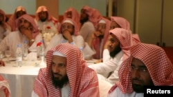 FILE - Members of Saudi Arabia's Committee for the Promotion of Virtue and Prevention of Vice, or religious police, also known as Haia or Mutawaa, attend a training course in Riyadh September 1, 2007.