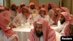 FILE - Members of Saudi Committee for the Promotion of Virtue and Prevention of Vice, or religious police, attend a training course in Riyadh.