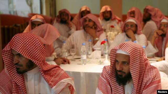 FILE - Saudi members of the Committee for the Promotion of Virtue and Prevention of Vice, or religious police, attend training in Riyadh, Sept. 1, 2007.
