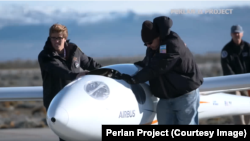 Members of the Perlan II project with the glider.