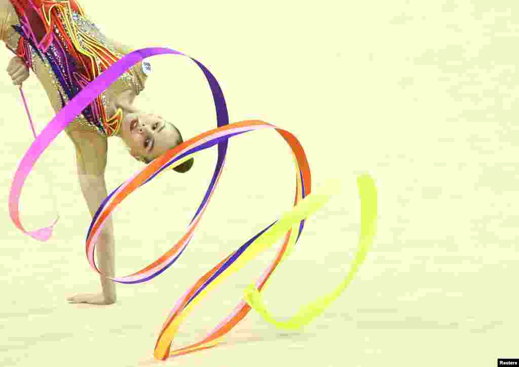 Anastasiia Salos of Belarus competes during the Rhythmic Gymnastics Individual Ball Final in Varna, Bulgaria.