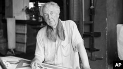 Frank Lloyd Wright, one of the greatest architects of the 20th century, is seen in his studio and home in Spring Green, Wisconsin, Aug. 16, 1938.