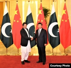 Pakistani Prime Minister Imran Khan with Chinese President Xi Jinping ahead of their meeting Nov. 2, 2018, in Beijing, China. (Pakistani Prime Minister's Office via Ayaz Gul)