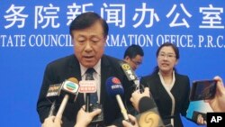 Yu Kangzhen, China's Vice President of Agriculture and Rural Affairs, answers questions at a press conference in Beijing on Thursday, July 4, 2019. (AP Photo/Sam McNeil)