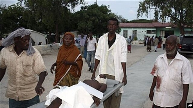 Wounded civilian at Madina hospital with injuries from roadside blast, Mogadishu, Somalia, Nov, 22, 2011.