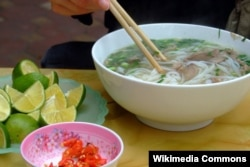 A bowl of pho and its condiments, as served in the Cầu Giấy district, Hanoi. (Wikimedia - Codename5281)