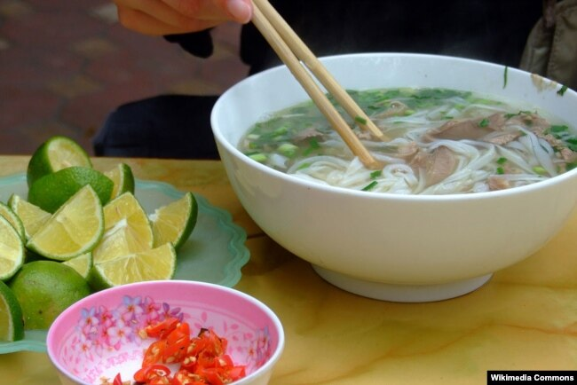 A bowl of pho and its condiments, as served in the C?u Gi?y district, Hanoi. (Wikimedia - Codename5281)