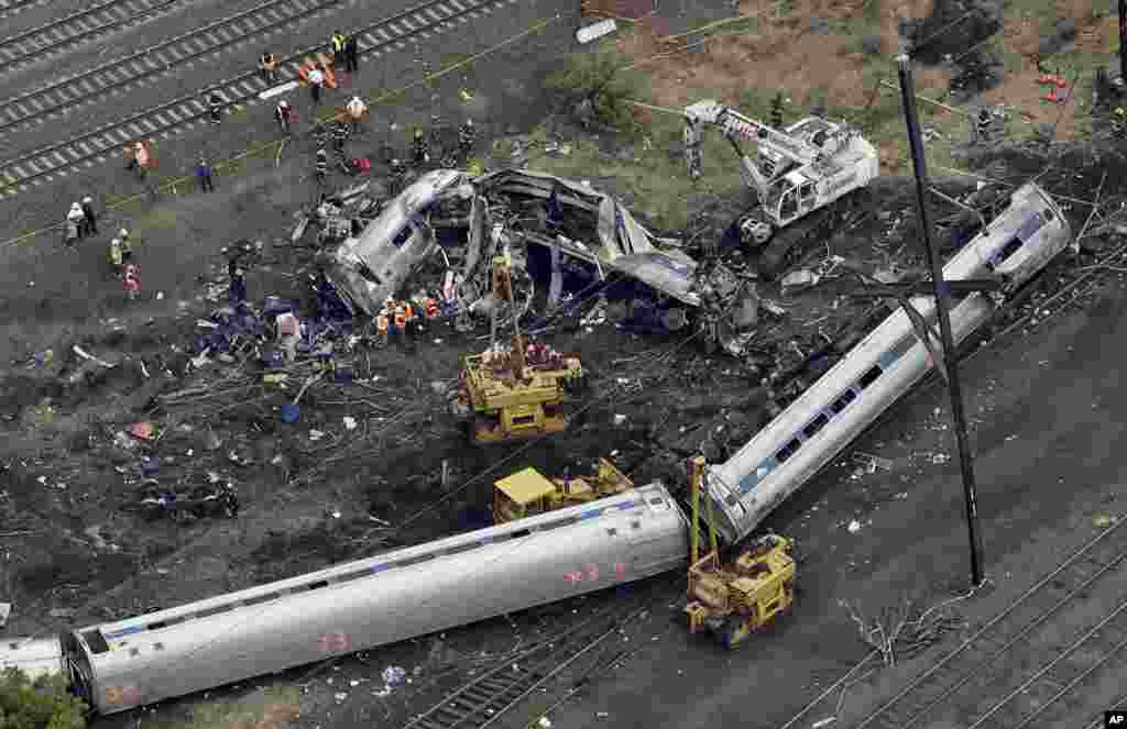Emergency personnel work at the scene of a deadly train derailment in Philadelphia. The Amtrak train, headed to New York City, derailed and crashed in Philadelphia, killing at least six people and injuring more than 200.