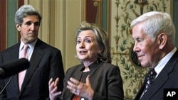 Secretary of State Hillary Rodham Clinton, center, flanked by Sen. John Kerry, D-Mass., left, and Sen. Richard Lugar, R-Ind., talks about the START Treaty following their meeting on Capitol Hill in Washington, 17 Nov 2010