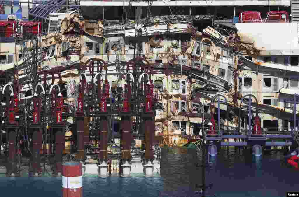 A damaged portion of the cruise liner Costa Concordia is seen in detail at Giglio harbour, Giglio Island, July 13, 2014.
