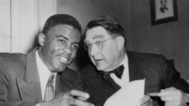 Jackie Robinson and Brooklyn Dodgers President Branch Rickey sign player's agreement