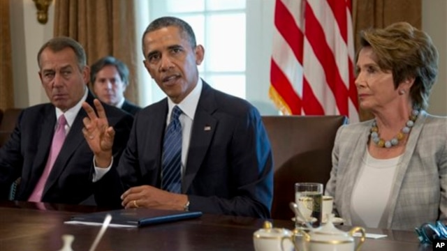 President Barack Obama, flanked by House Speaker John Boehner of Ohio (L) and House Minority Leader Nancy Pelosi of California, speaks to the media before a meeting at the White House with lawmakers on the situation in Syria.