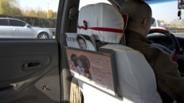 A window handle on the door at the back seat is seen removed in a taxi in Beijing Nov. 1, 2012.