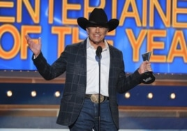 George Strait accepts the award for Entertainer of the Year at the 49th annual Academy of Country Music Awards at the MGM Grand Garden Arena in Las Vegas, April 6, 2014.