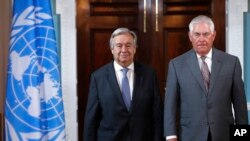 Secretary of State Rex Tillerson, right, walks with ‎U.N. Secretary-General Antonio Guterres, Wednesday, June 28, 2017, at the State Department in Washington.