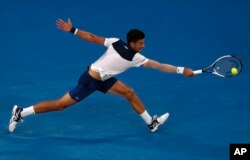 Serbia's Novak Djokovic reaches for a backhand return to South Korea's Chung Hyeon