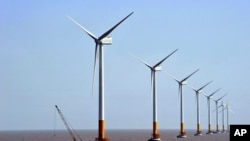 FILE - A Chinese-owned company hopes to build an off-shore wind farm in Oregon, like this one in Shanghai.