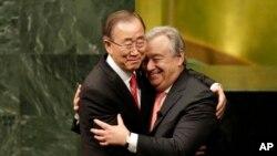 Current Secretary-General Ban Ki-moon, left, hugs U.N. Secretary-General designate Antonio Guterres after Guterres was sworn in at U.N. headquarters, Monday, Dec. 12, 2016. (AP Photo/Seth Wenig)