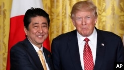 President Donald Trump and Japanese Prime Minister Shinzo Abe shake hands following their joint news conference in the White House in Washington, Feb. 10, 2017.