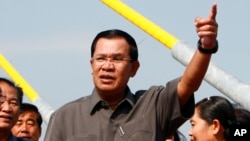 Cambodia's Prime Minister Hun Sen, center, gestures during a ceremony inaugurating the country's longest bridge in Neak Loeung, southeast of Phnom Penh, Cambodia, Wednesday, Jan. 14, 2015.