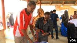 Workers help refugees check-in for repatriation flight to Mogadishu, Dadaab, Kenya, September 21, 2016.