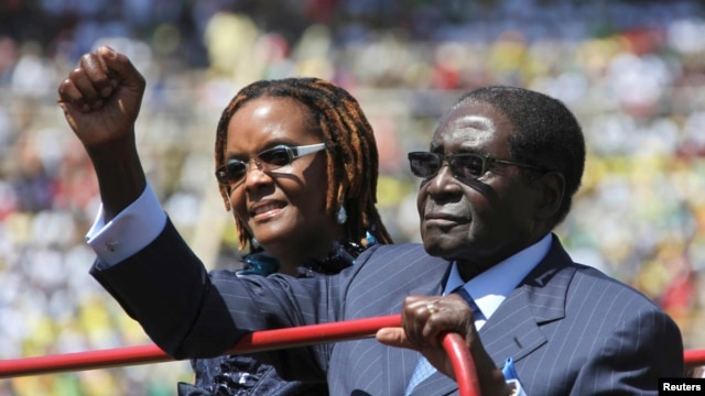 Zimbabwe President Robert Mugabe and his wife, Grace, arrive for his inauguration as president, in Harare, in this August 22, 201, file photo.