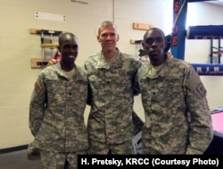 "Soldiers and 2016 track and field Olympians, from left, Spc. Shadrack Kipchirchir, Staff Sgt. John Nunn and Spc. Paul Chelimo pose in Fort Carson's boxing training room, nicknamed ""The House of Pain."""