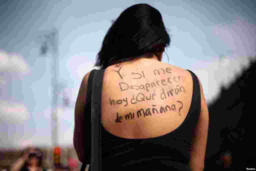"A woman takes part in a demonstration in Mexico City, demanding justice for the female victims of violence in Mexico, Feb. 25, 2018. The words written on her back read: ""And if I disappear today, what would they say about me tomorrow?""."