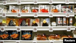 FILE - Food products are displayed at Lawson Open Innovation center during an event introducing its next-generation convenience store model in Tokyo, Japan December 4, 2017. (REUTERS/Kim Kyung-Hoon/File Photo)